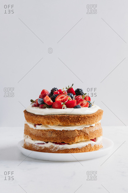 Forest fruit nude cake on a marble surface