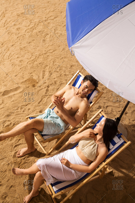 Romantic young lovers on the beach