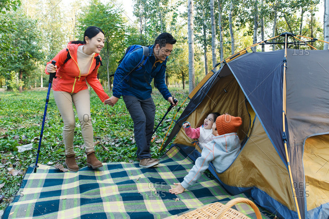 Happy family camping in the open air