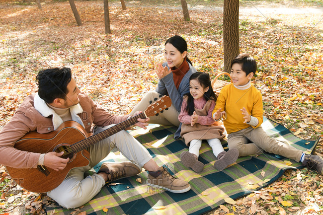 Happy families play outdoors