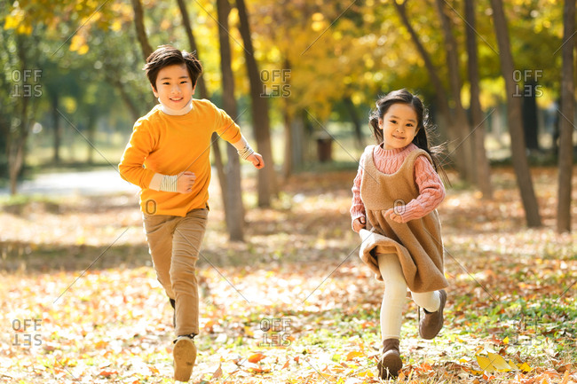 Happy children run in the open air