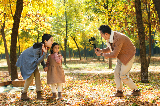 Happy family in the outdoor taking pictures