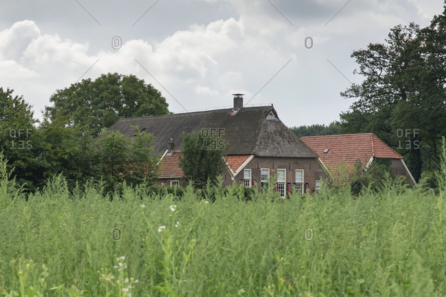Cloudy sky over brick country home