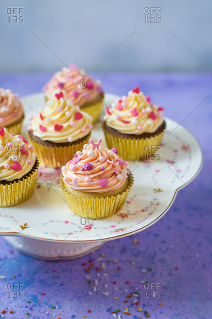 Elegant pink and white cupcakes decorated with sprinkles and pearls