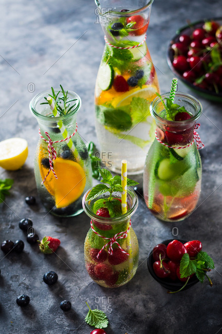 Flavored Water with Berries. Orange, Lemon, Cucumber  and Fresh Herbs