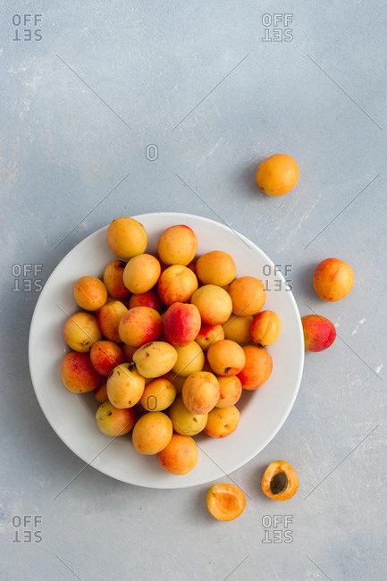 Overhead view of freshly picked apricots in plate