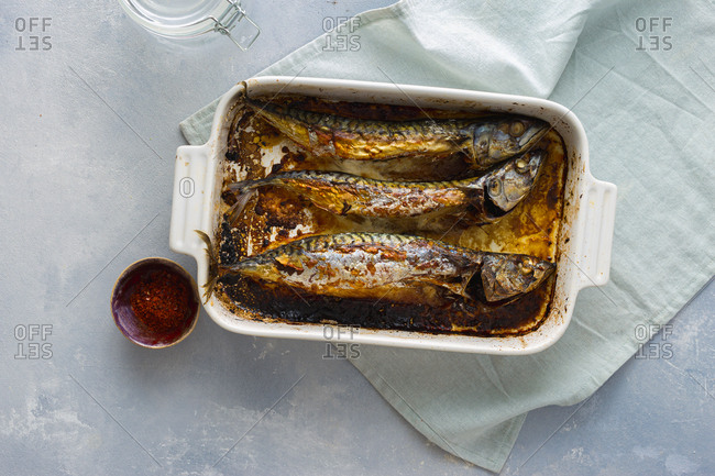 Freshly baked mackerel in a baking dish