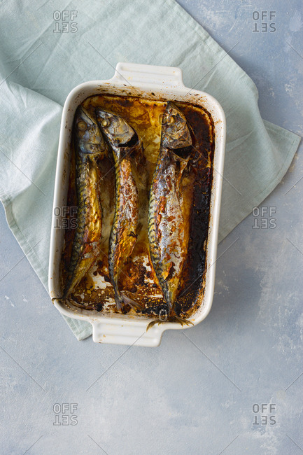 Overhead view of freshly baked mackerel in a baking dish