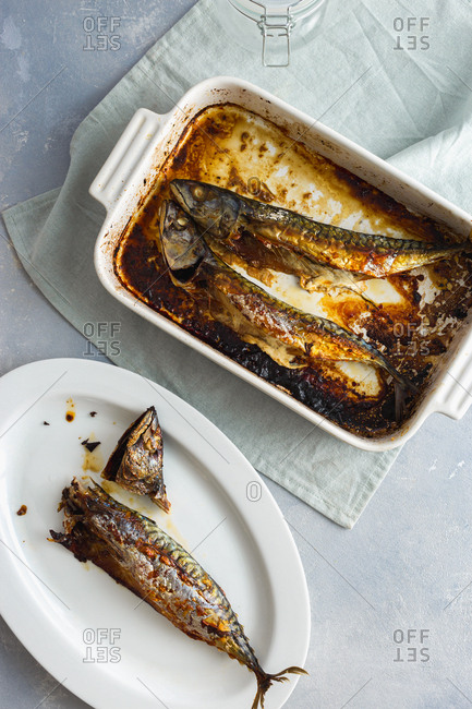 From above baked mackerel in a baking dish