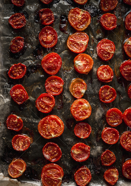 Baked tomatoes in tray close up