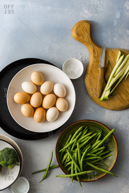 Ingredients for cooking fried eggs with zucchini, broccoli and string beans