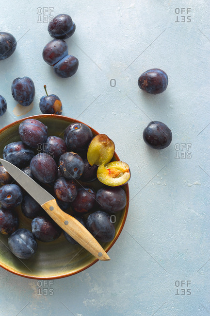 Plate full of sweet freshly picked plums from above