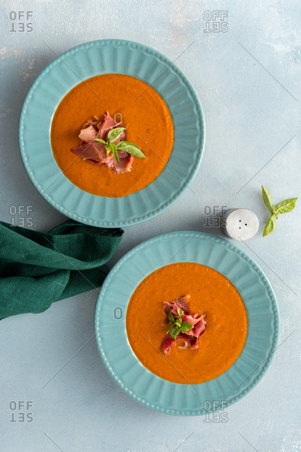 Bowl of creamy roasted tomato soup with ham