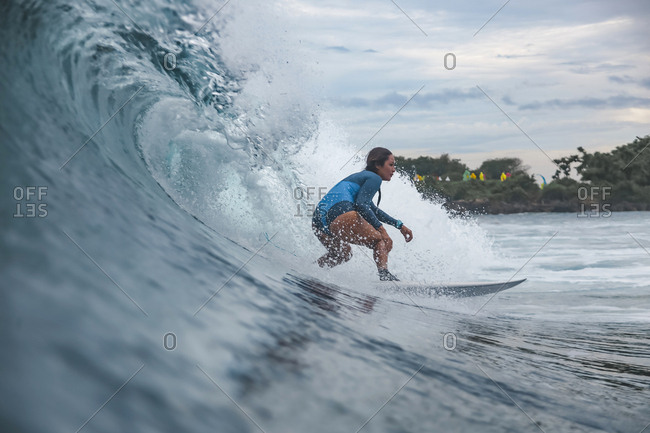 Low angle view of woman surfing in sea