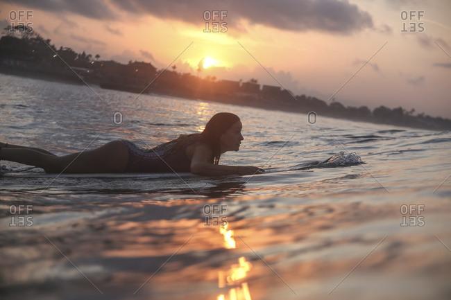 Female surfer in ocean