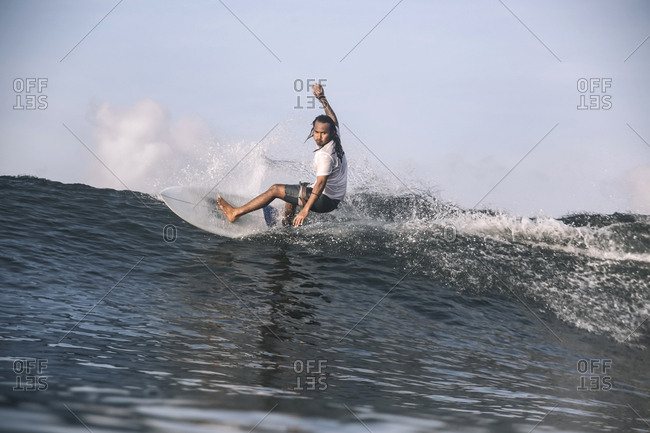 Carefree man surfing on sea