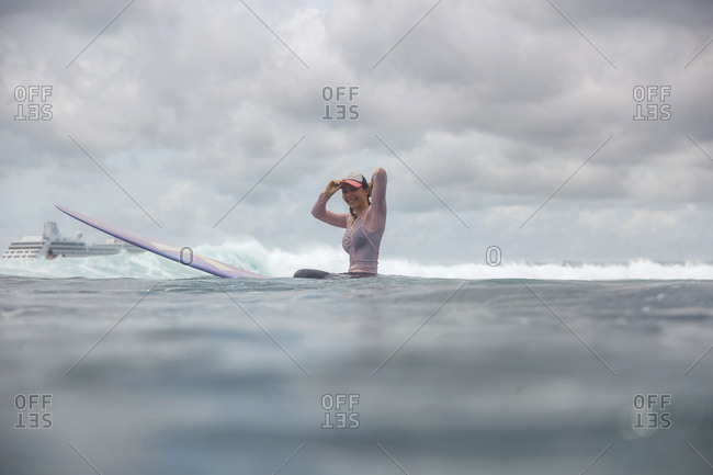 Female surfer in an ocean