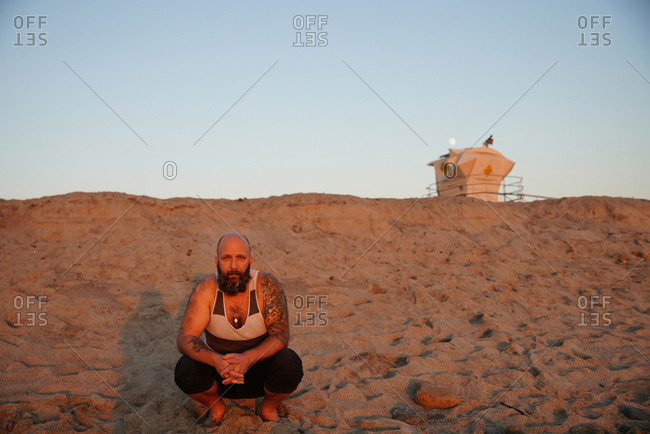 portrait of man on beach during golden hour