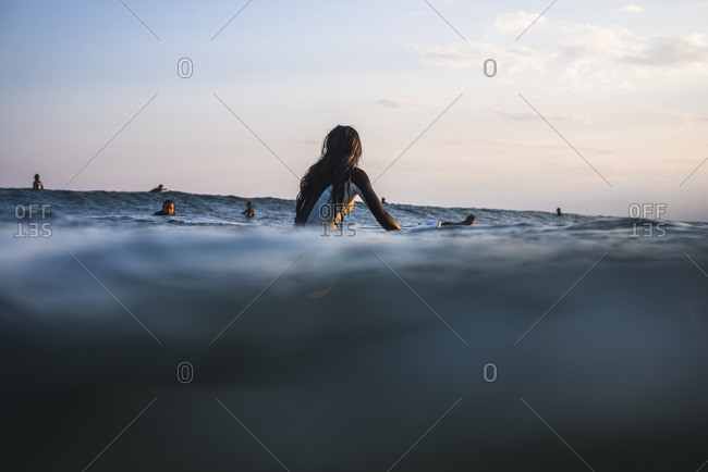 Young Woman waiting for Waves at Golden Hour