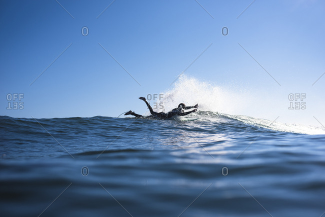 Young Man enthusiastic with Surf stoke