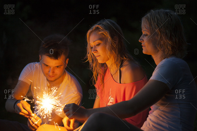 Dancing with sparklers in the evening celebrating summer and having a free spirt