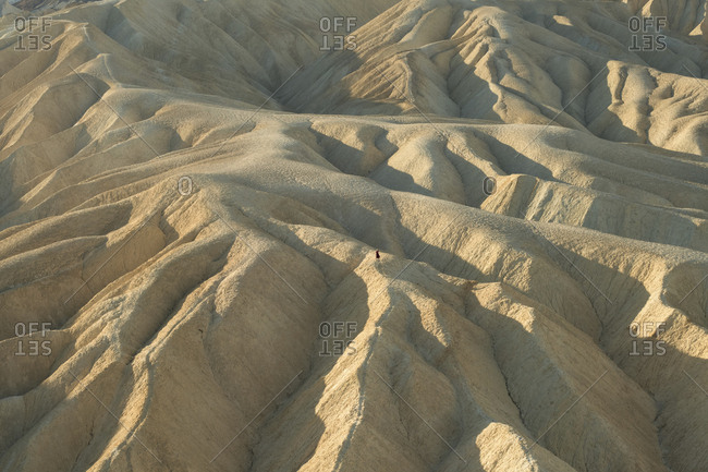 Distant view of woman at Zabriskie Point in Death Valley National Park