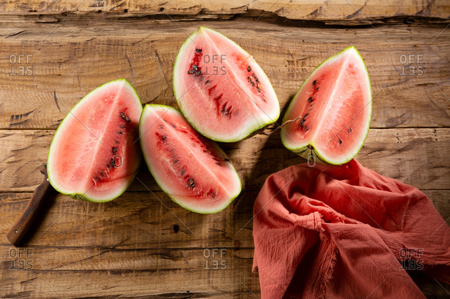 Watermelon on brown background top view
