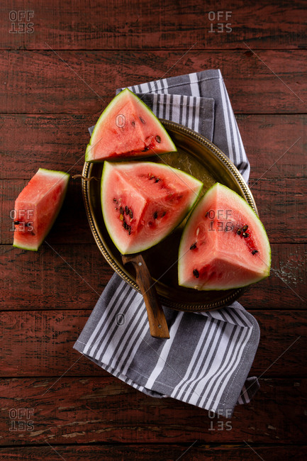 Fresh and ripe watermelon on rustic background