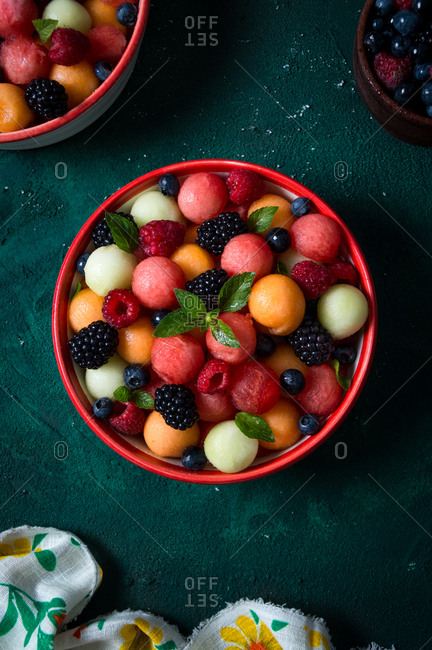 Watermelon, melon and berries fruit salad with mint