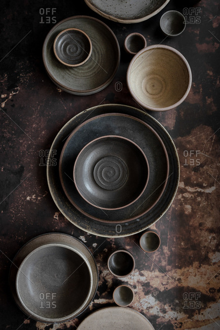 Dark gray ceramic plates and bowls displayed on a table