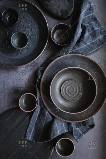 Dark gray ceramic plates and bowls