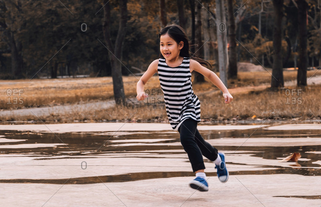 The girl runs in a public park