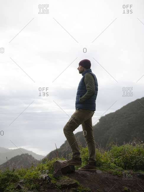 Young Pensive Man Looking At Mountain Landscape Of Tenerife From Cliff