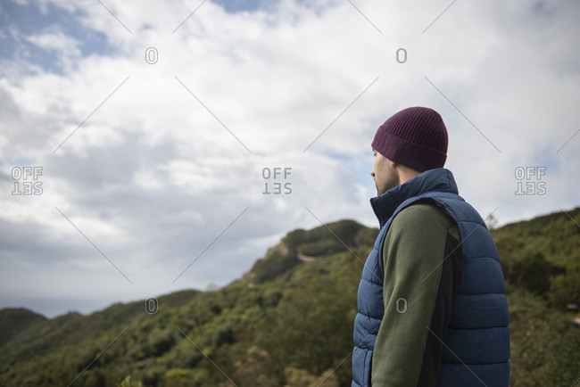 Rear View Of Handsome Man Looking At Mountain Landscape Of Tenerife