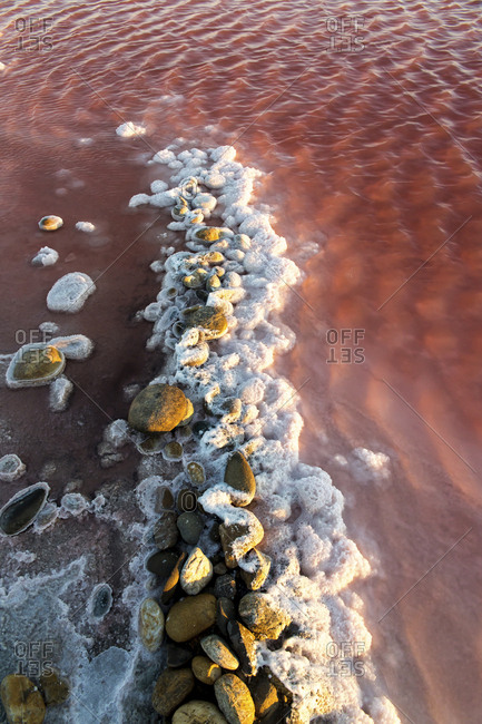 High angle view of pebbles in salt flat