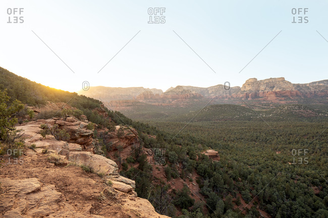 Scenic view of landscape against clear sky during sunrise