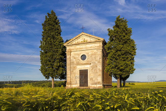 Tuscany church surrounded by cypresses