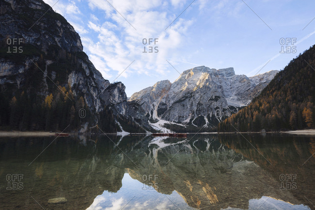 Scenic view of Lake Braies by mountains against sky during winter