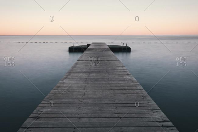 Wooden pier on the sea. Long exposure photo. Budva, Montenegro