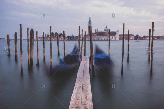 Evening view of gondolas on the wave and San Giorgio Maggiore
