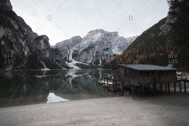 Wooden boats at the alpine mountain lake. Lago di Braies