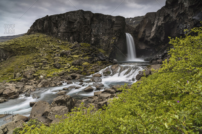 Scenic view of waterfall at Iceland