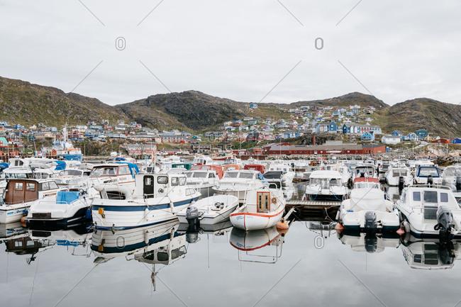 Qaqortoq, Greenland - September 6, 2018: Small fisher boats on Qaqortoq harbor