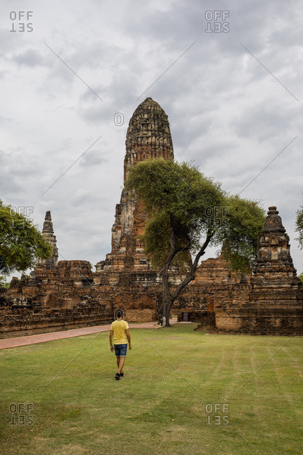 Man visiting Ayutthaya, the ancient city of Thailand
