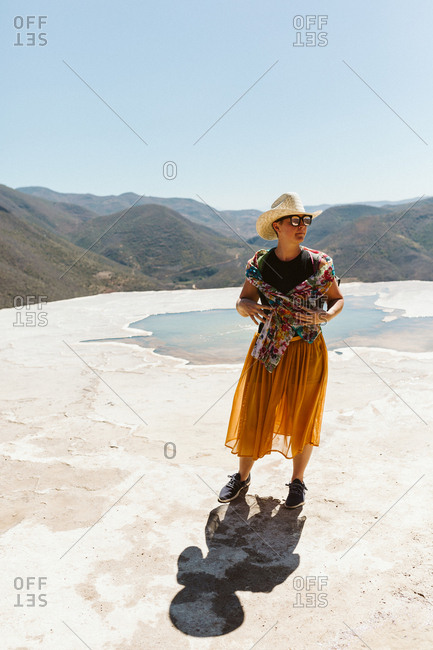 woman in colorful skirt and scarf at hierve del agua oaxaca mexico