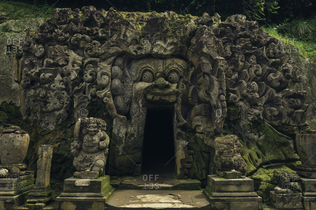 Demon carvings on entrance of cave temple
