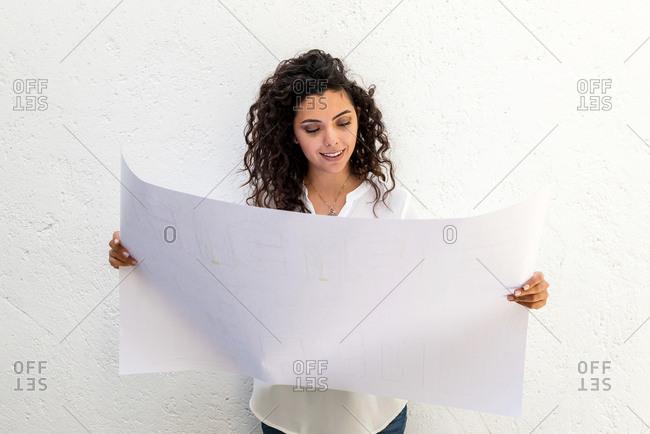 Portrait of an architect woman with blueprints