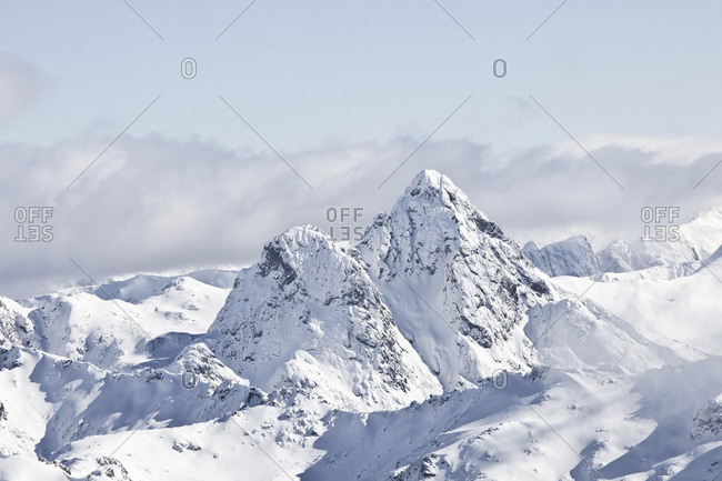 Tranquil view of snowcapped mountains against sky during winter