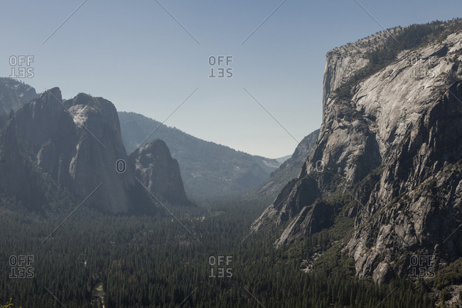 Scenic view of mountains and forest against clear sky at Yosemite National Park