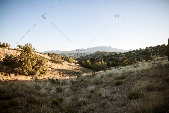 desert view at sunset with mountains in background